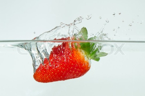 2877352-fresh-strawberry-dropped-into-water-with-splash-on-white-backgrounds